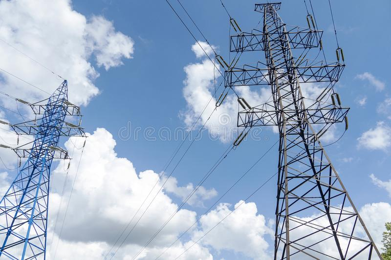 Two electric high voltage posts with wires. A metal pole with powerful electricity royalty free stock image