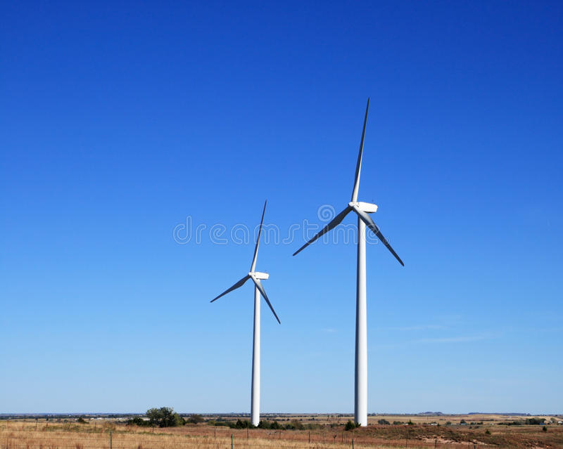 Two electric windmills royalty free stock photography