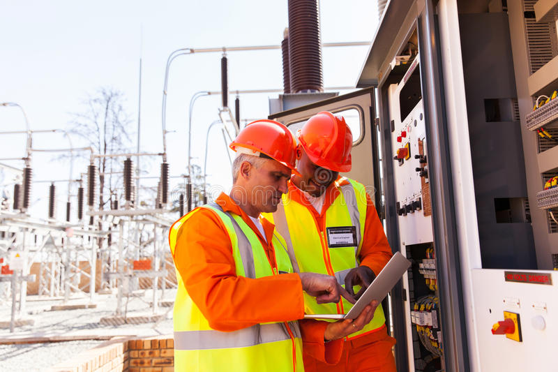 Two electrical engineers stock photography