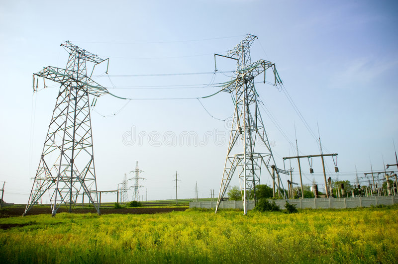 Two electrical towers on blue sky background stock photography