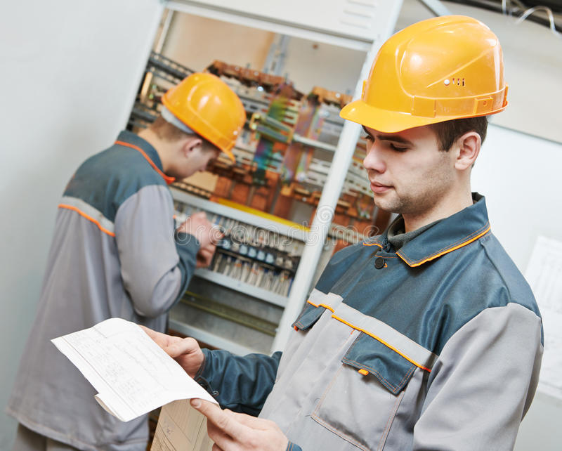 Two electrician workers royalty free stock images