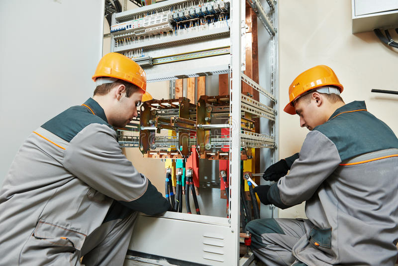 Two electrician workers royalty free stock image