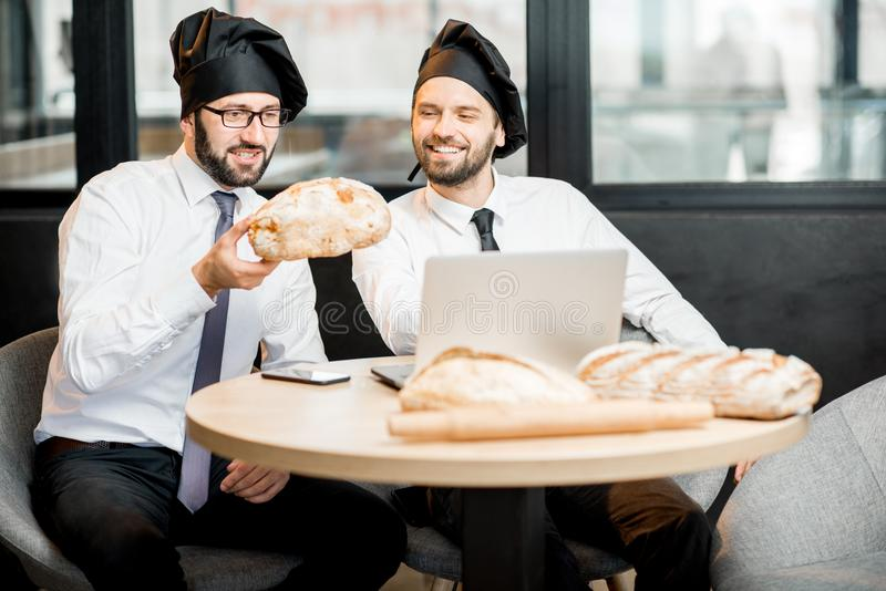 Bakers working with bread in the office stock photo