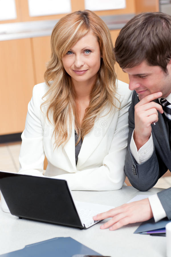Two elegant businesspeople working. On a presentation in the cafeteria royalty free stock images