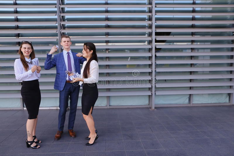Two elegant young women, business ladies and handsome young male stock photos