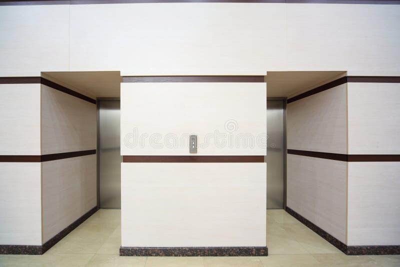 Two elevators with closed metallic doors