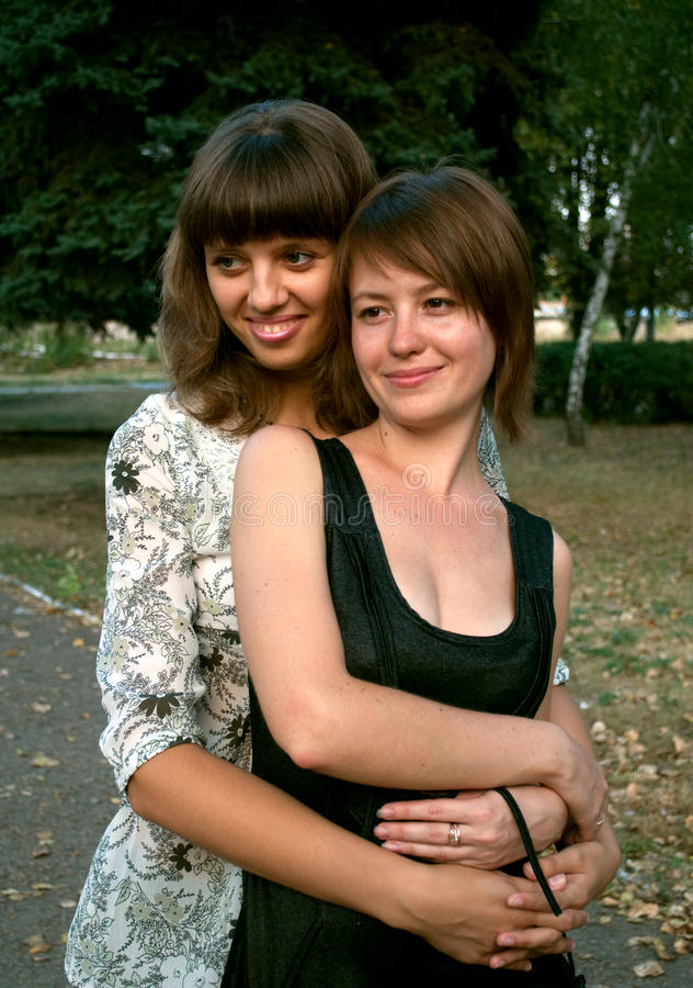 Two embracing girls stock photography