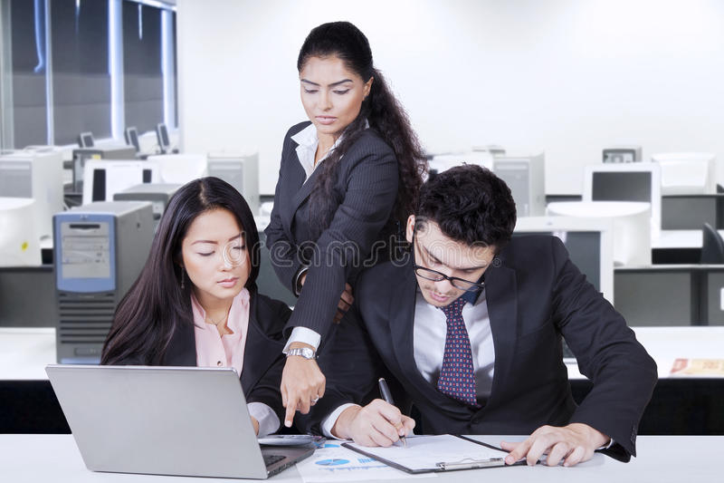 Two employee and leader with report financial royalty free stock photography