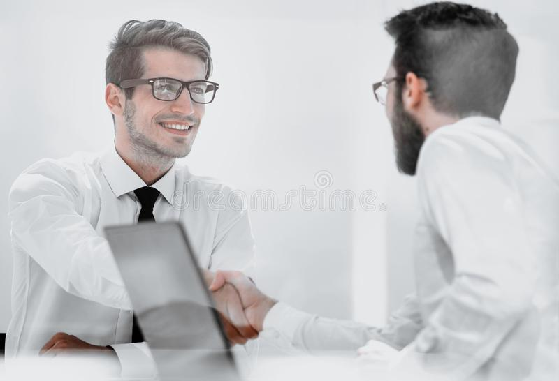 Two employees greet each other at the Desk royalty free stock image