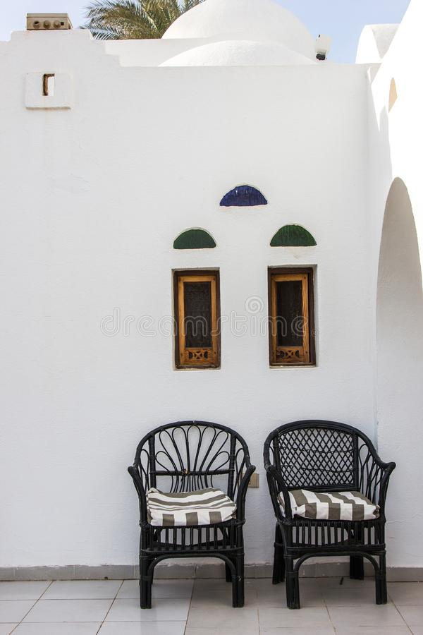 Two empty chairs near white building. In Egypt royalty free stock images