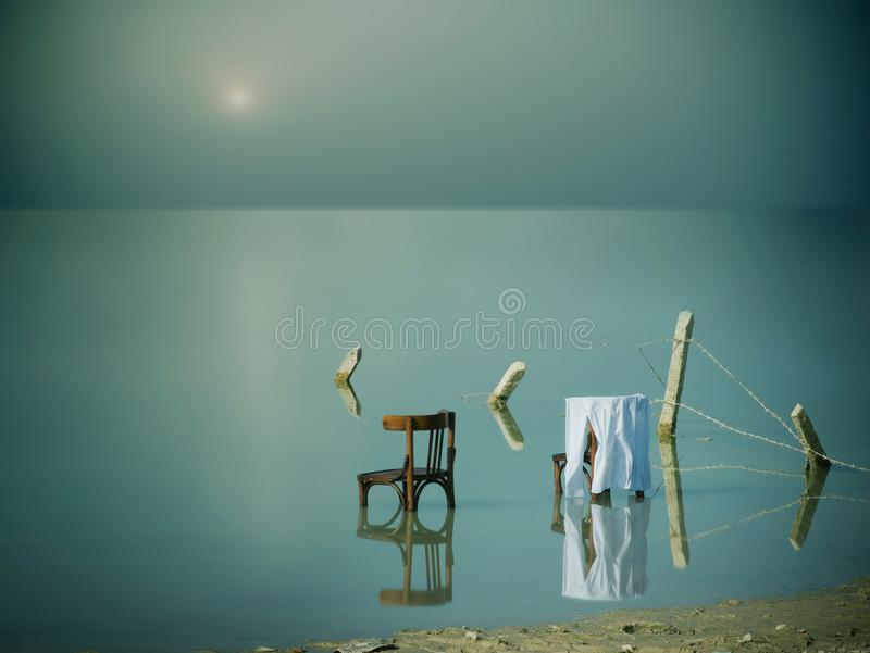 Two empty chairs and one shirt. royalty free stock image