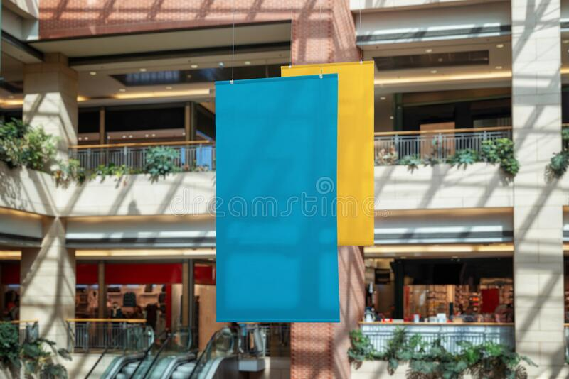 Two empty clean banners hanged inside the shopping mall. Copy space for promo text or logo promotion royalty free stock photography