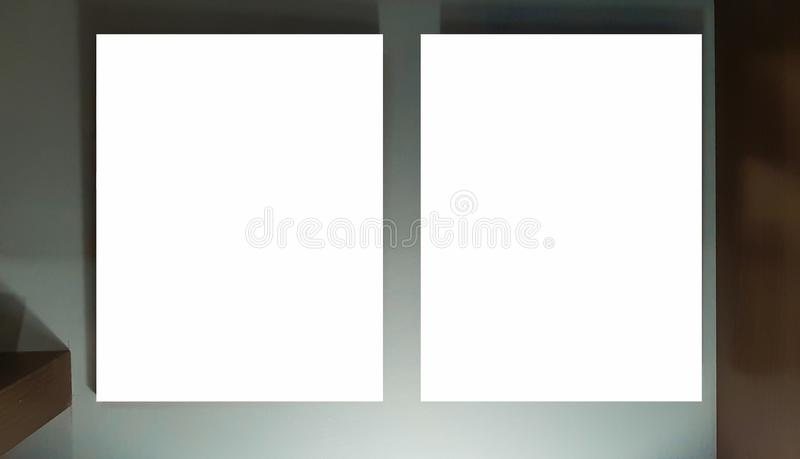 Two Empty Frame On The Shelf With Books.Blank Advertisement Banner Poster Mock Up Isolated Template Clipping Path. Empty Picture Frame Blank Advertisement Banner royalty free stock photography