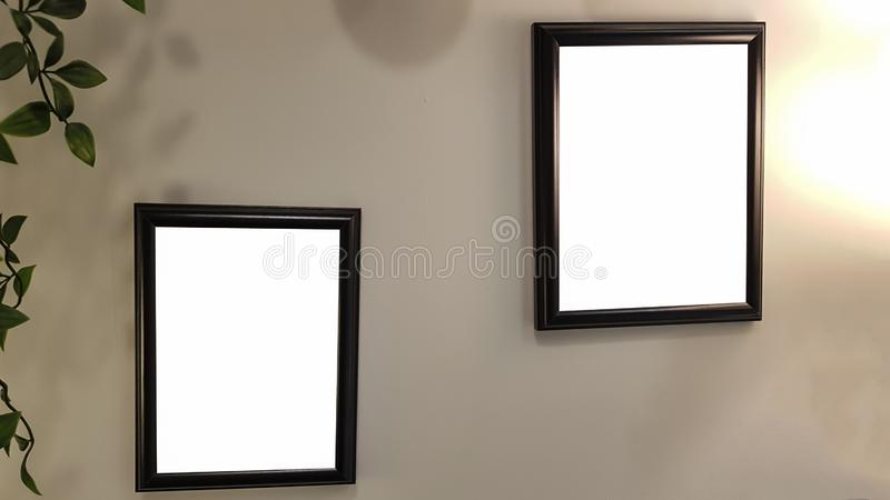 Two Empty Frame On The Shelf With Books.Blank Advertisement Banner Poster Mock Up Isolated Template Clipping Path. Empty Picture Frame Blank Advertisement Banner royalty free stock photo