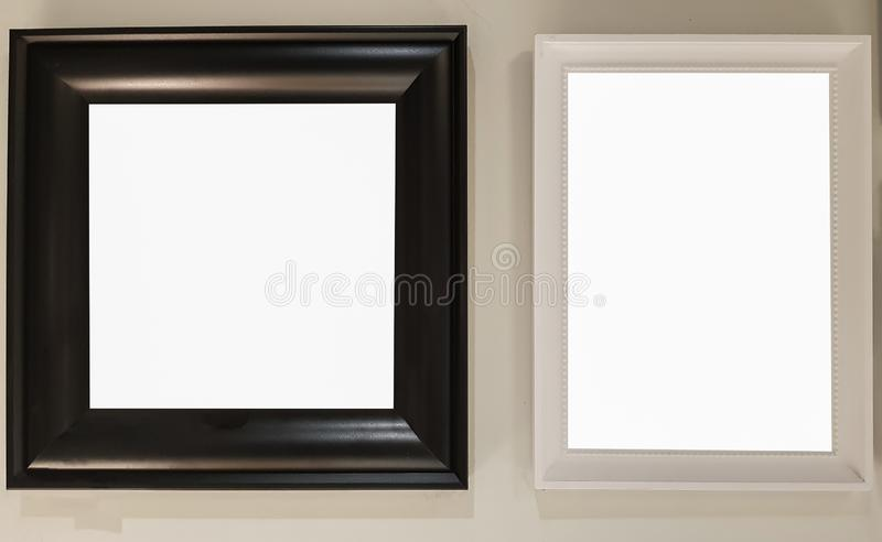 Two Empty Frame On The Shelf With Books.Blank Advertisement Banner Poster Mock Up Isolated Template Clipping Path. Empty Picture Frame Blank Advertisement Banner stock photography