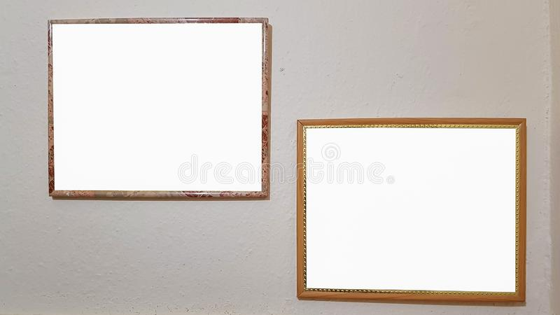 Two Empty Frame On The Shelf With Books.Blank Advertisement Banner Poster Mock Up Isolated Template Clipping Path. Empty Picture Frame Blank Advertisement Banner royalty free stock photos