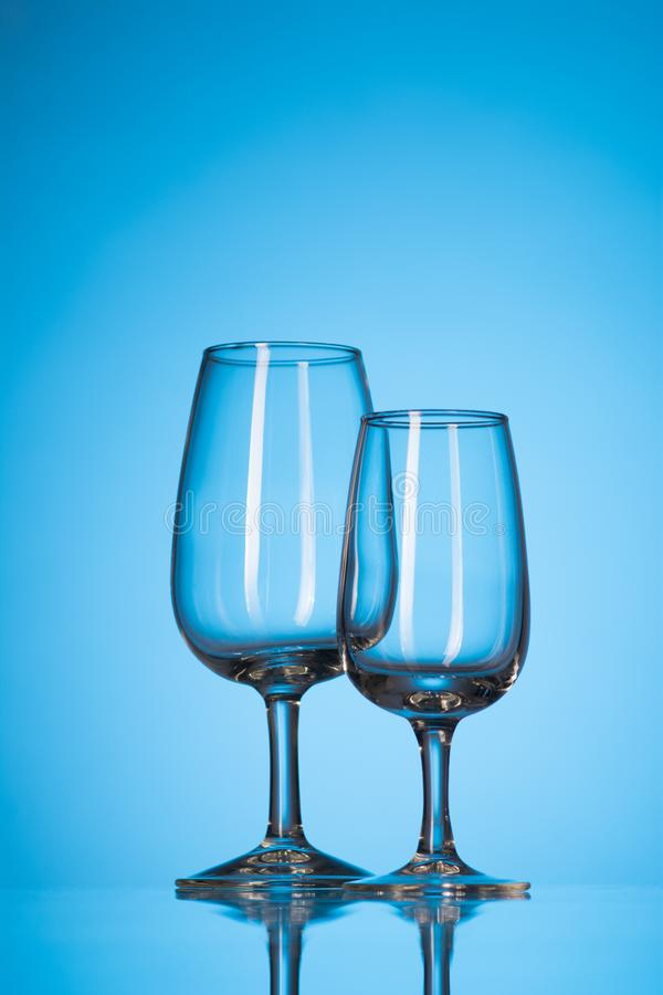 Two empty glasses for cocktail stock images