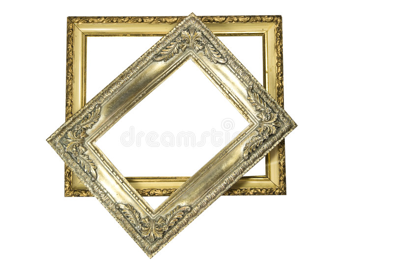 Two Empty Picture Frames. Two decorative, isolated, picture frames one on top of another stock photos