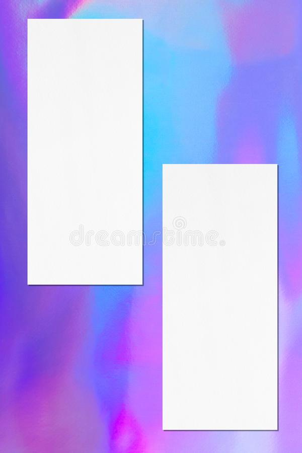 Two empty price-list or menu mockups on holographic background. Two empty price-list or menu mockups with soft shadows on holographic background. Flat lay, top royalty free stock photography
