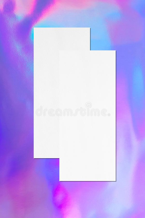 Two empty price-list or menu mockups lying on top of each other on holographic background. Two empty price-list or menu mockups lying on top of each other with stock illustration
