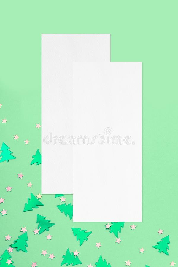 Two price-list or menu mockups on christmas mint background. Two empty price-list or menu mockups with soft shadows lying on top of each other on mint background stock photo