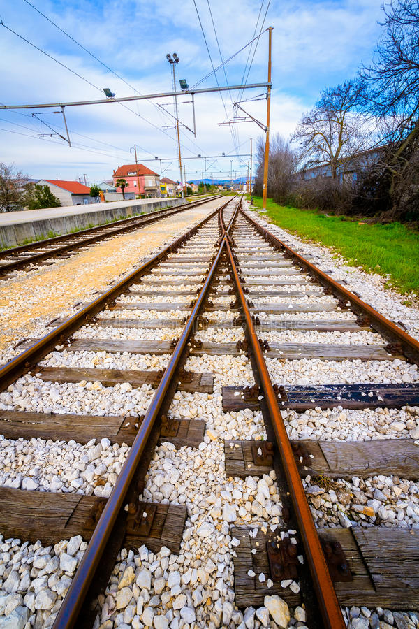 Two empty railway lines joining in the distance royalty free stock photos