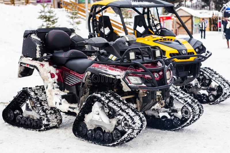 Two empty snowmobiles royalty free stock photo
