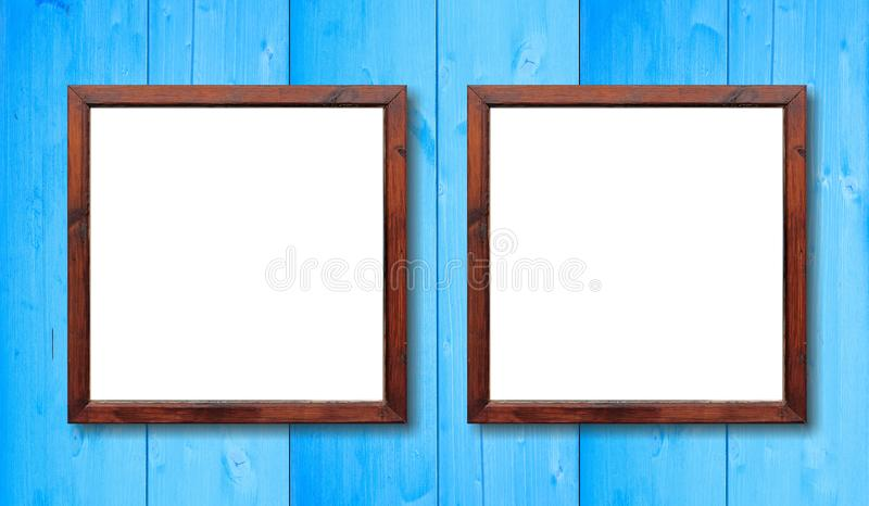 Two Empty Wooden Frames On The Wall. White Inside And Light Blue ...