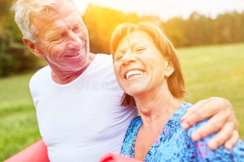 In love seniors go for a walk in the park royalty free stock images
