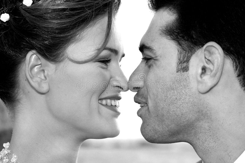 Two enamoured. Kiss stock images