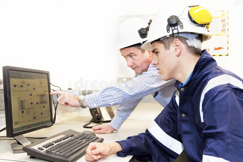 Two engineers discussing work together in office royalty free stock images