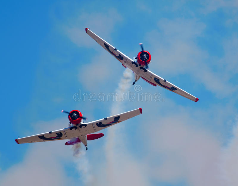 Two Eqstra Harvards break formation stock photos