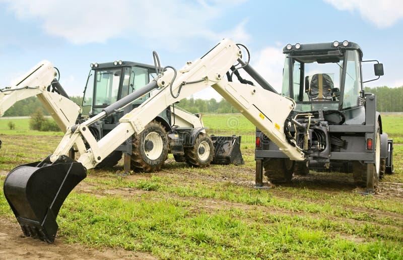 Two excavators stock photos