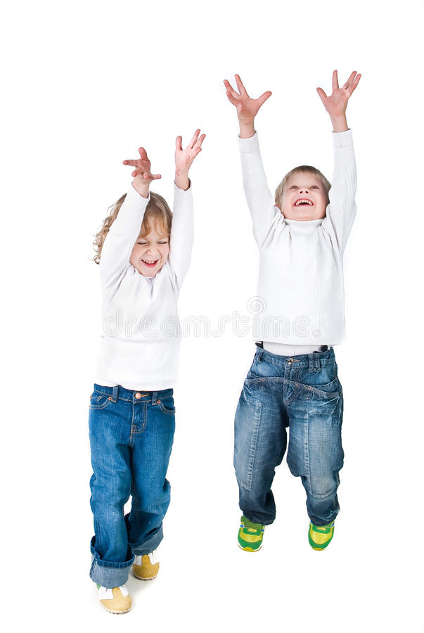 Two excited kids jumping up isolated on white. Background royalty free stock photography
