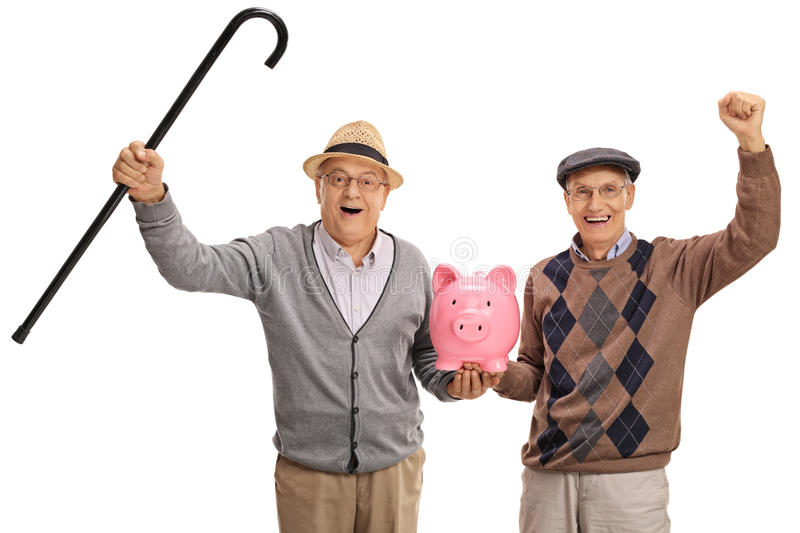 Two excited mature men holding a piggybank. Isolated on white background royalty free stock photo