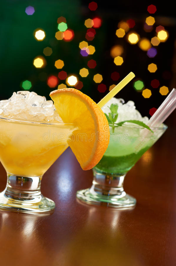 Two exotic cocktails in bar. Two exotic fruity cocktails in bar stock photos