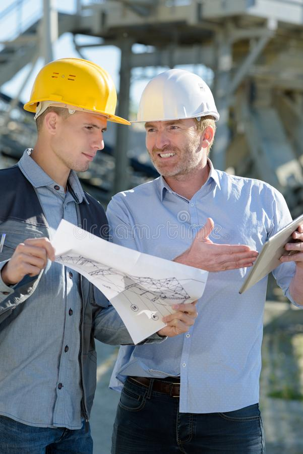 Two experts supervising construction royalty free stock images