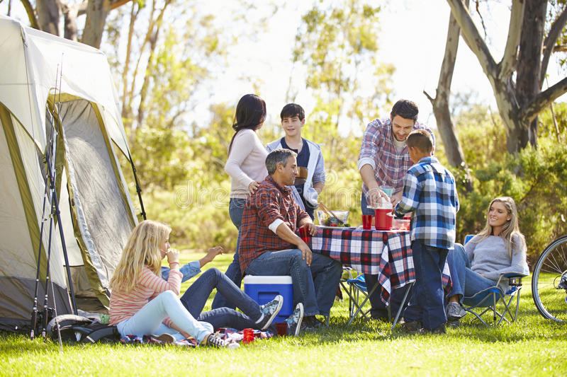 Two Families Enjoying Camping Holiday In Countryside Stock Images