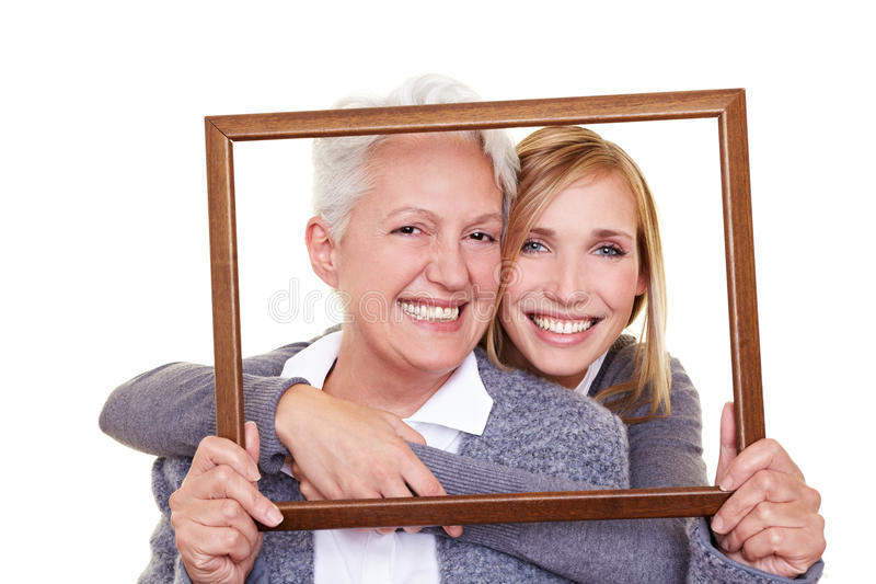Two family generations in frame royalty free stock photo