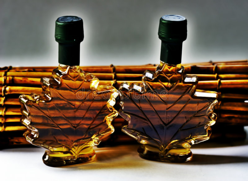 Two fancy maple syrup bottles stock photos