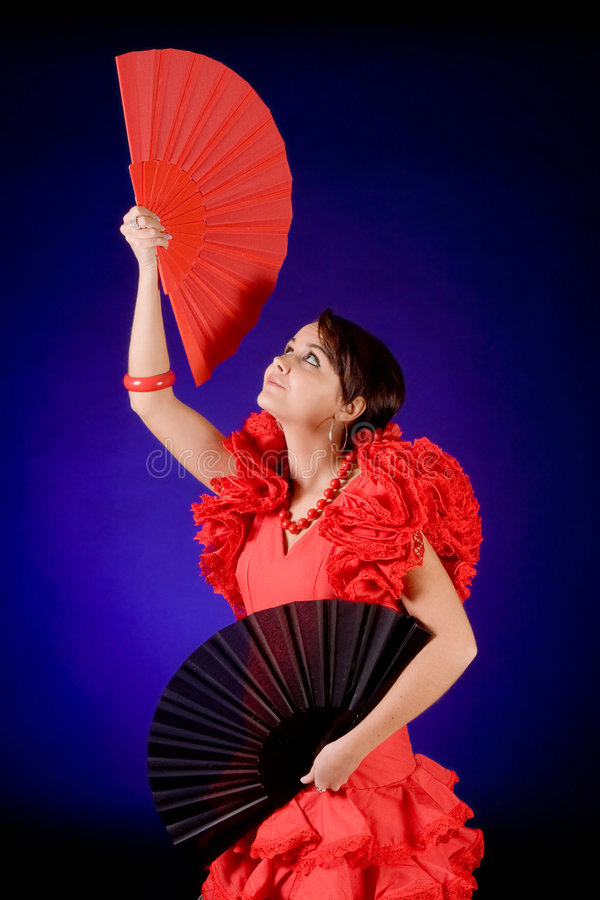 Two fans. Young Spanish Flamenco dancer with two fans stock photography