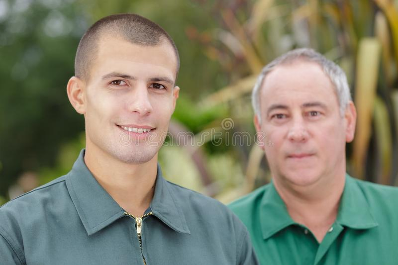 Two farmers working on field stock photo