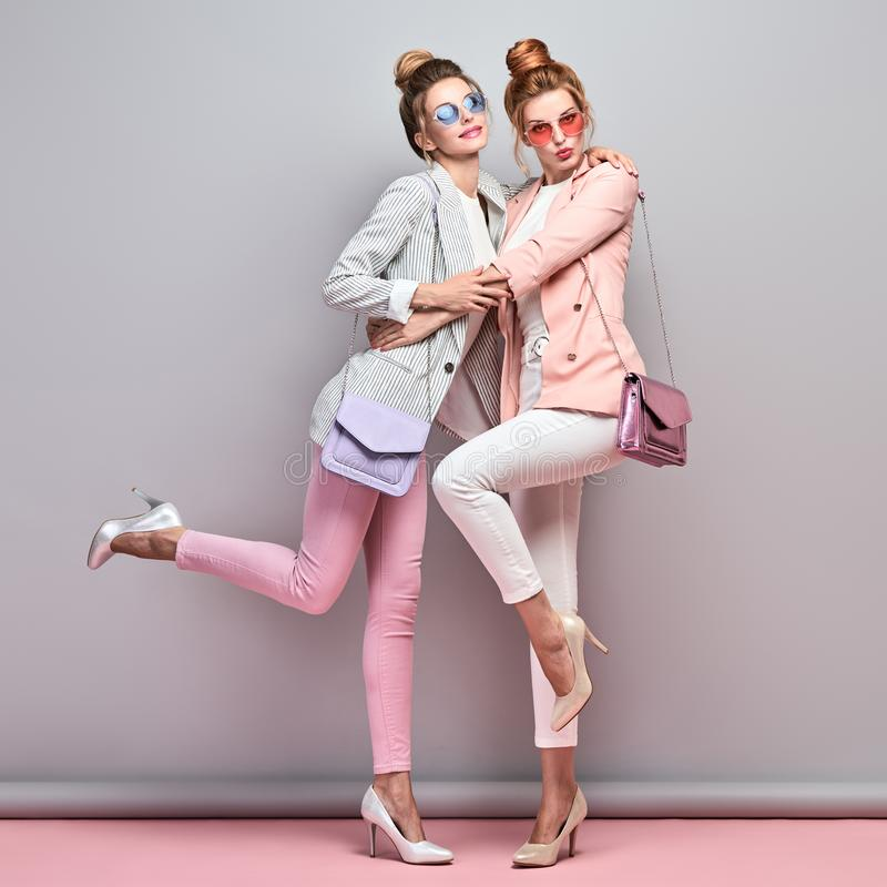 Two Fashion autumn having fun, Trendy fall outfit royalty free stock images