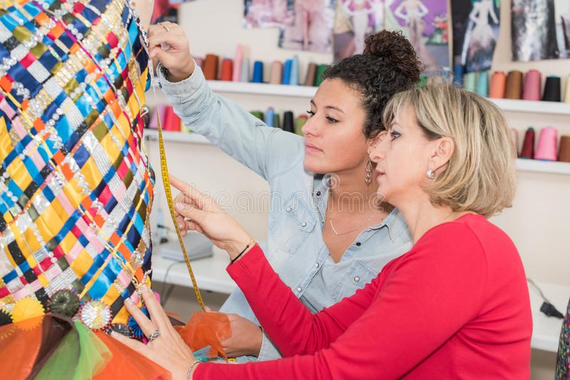 Two fashion designers working together stock photography