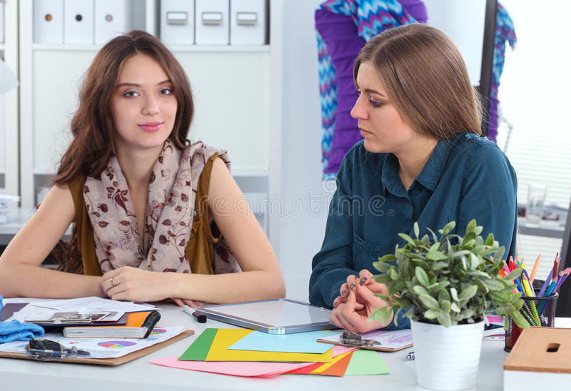 Two fashion designers working together at the desk royalty free stock image
