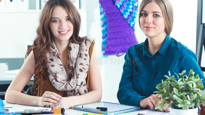 Two fashion designers working together at the desk stock photos