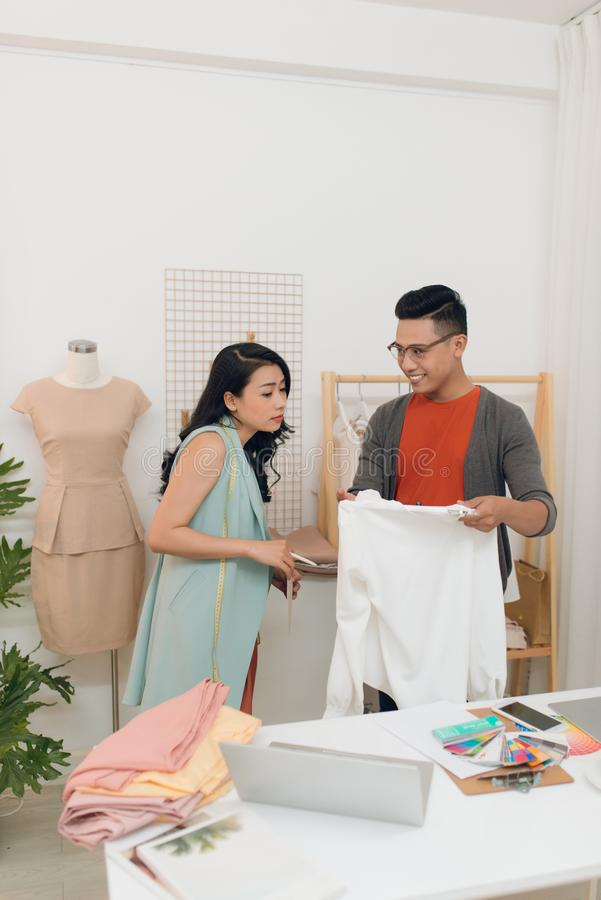 Two fashion designers working together on a desk stock image