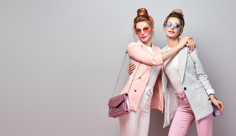 Two Fashion woman having fun, Trendy summer outfit royalty free stock image