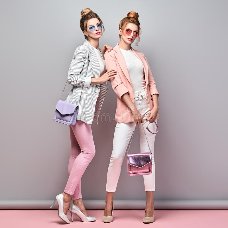 Two Fashion woman having fun, Trendy summer outfit stock photography