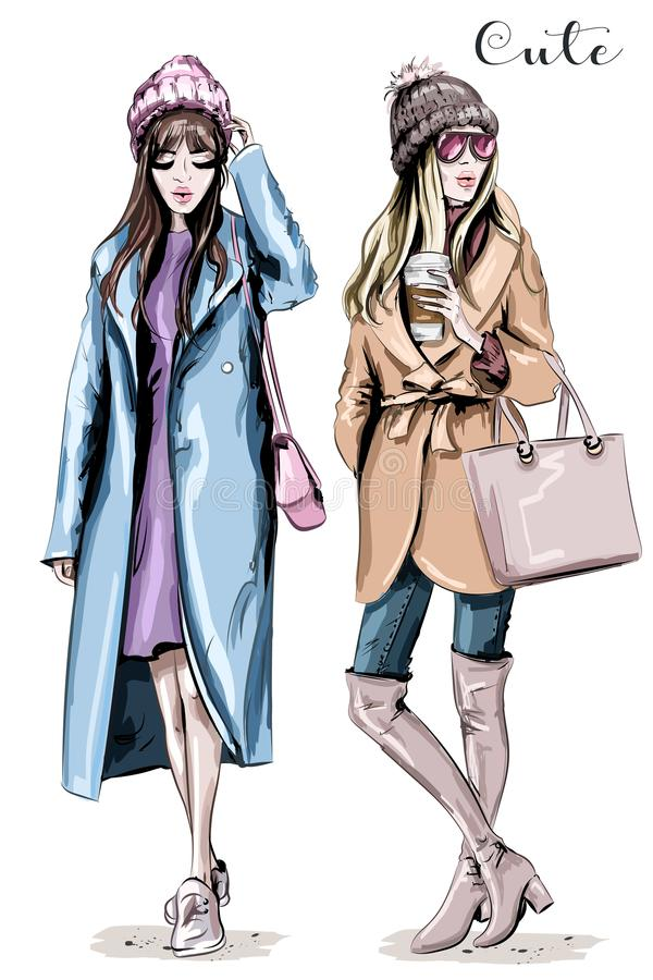 Two fashion women. Hand drawn stylish beautiful women in winter clothes. Fashion winter outfits. vector illustration